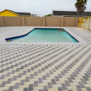 completed paving job around swimming pool